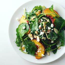 baby kale salad with peaches, feta cheese and toasted almonds | www.nyssaskitchen.com