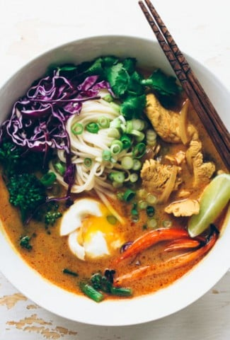 a satisfying and easy curry noodle soup made with chicken, udon noodles, red curry paste, garlic, ginger, turmeric, onions, red peppers, broccolini, soft boiled eggs and finished with cilantro, green onions and shredded red cabbage. super delicious and could be easily adapted to vegetarian or gluten free! | www.nyssaskitchen.com