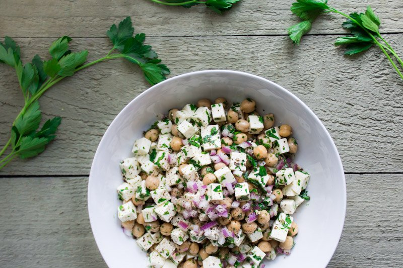 chickpea feta salad! a super easy and satisfying vegetarian recipe made with feta cheese, chickpeas, parsley, red onion, and a simple lemon and olive oil vinaigrette. a perfect make-ahead picnic salad! | www.nyssaskitchen.com
