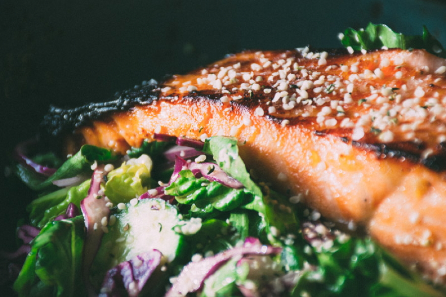 a mega healthy and flavorful recipe for garlicky miso marinated salmon with a big salad of fresh romaine and arugula, cucumbers, red cabbage and a lime and olive oil vinaigrette   www.nyssaskitchen.com