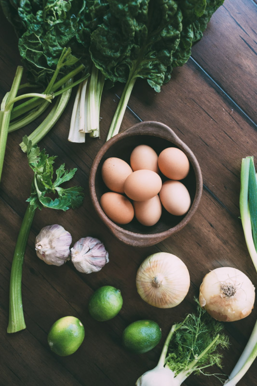 chard coconut detox soup with poached eggs: a vibrant and restorative soup made with chard, onion, fennel, celery and garlic, and paired with a nutritionally dense bone broth or vitamin rich vegetable stock + poached eggs to detox and support your body from the inside out!   www.nyssaskitchen.com