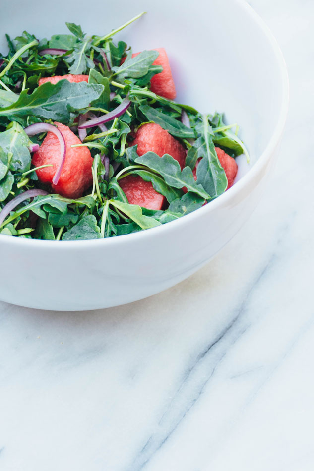 watermelon arugula salad with mint and red onion - a super easy and healthy salad made with juicy watermelon, red onion, fresh mint, arugula and a simple lime vinaigrette. the perfect summer salad! | www.nyssaskitchen.com