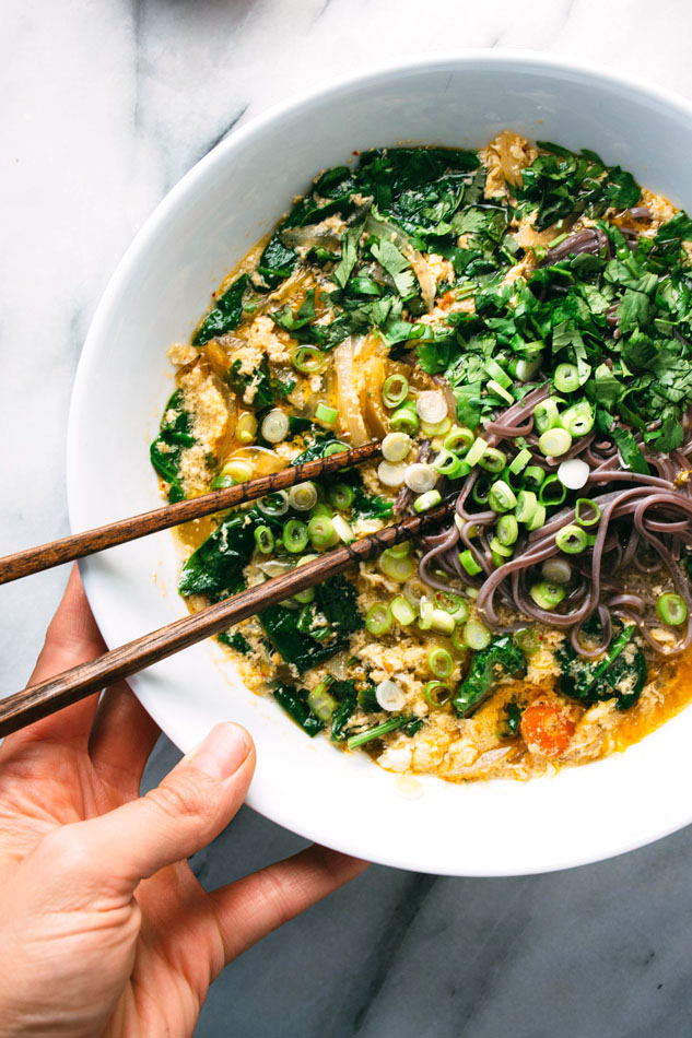 kimchi and buckwheat noodle egg drop soup! so super simple yet incredibly flavorful soup made with kimchi, spinach, buckwheat noodles and coconut milk. perfect for cool autumn days! can be made paleo by leaving out the noodles | www.nyssaskitchen.com