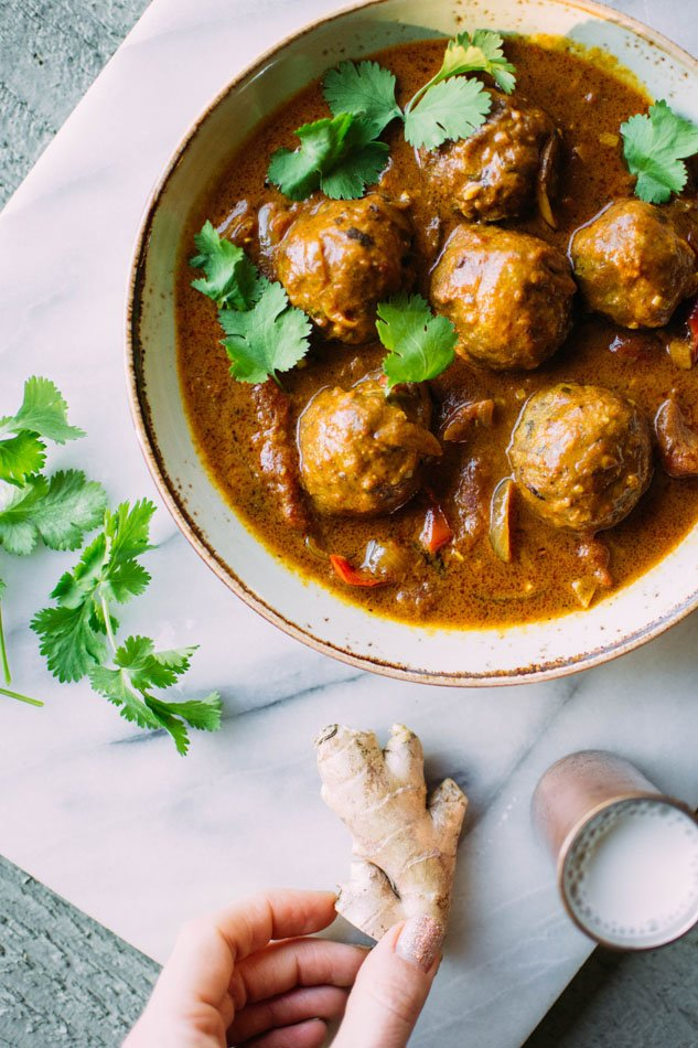 Best ever paleo curried pork meatballs! The most delicious grain free meatballs I've ever had. Perfectly spiced, sturdy yet tender, and paired with an incredibly flavorful curry sauce with red peppers, tomatoes, onion, garlic and ginger.