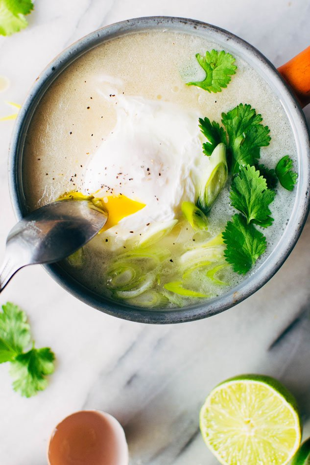 Simple sipping broth with a poached egg! Your perfect go-to healthy pick-me-up // fridge clean out meal when you need a little extra something in your life. Made with high quality broth, fresh herbs, coconut milk and a poached egg this little pot is gauranteed to having you feeling fine in no time!