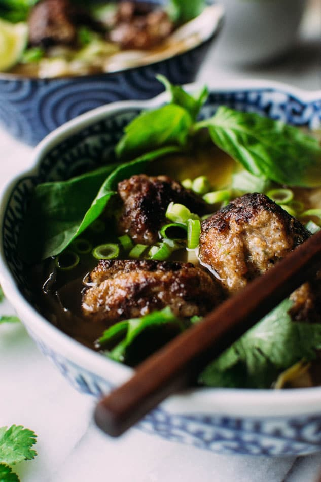 Royal pho broth with cabbage ribbons and vietnamese spiced pork meatballs - Incredibly easy and comforting pho soup that also happens to be grain free // paleo! Brimming with fragrant aromatics, tender ribbons of cabbage instead of noodles, and delightfully delicious pork meatballs.