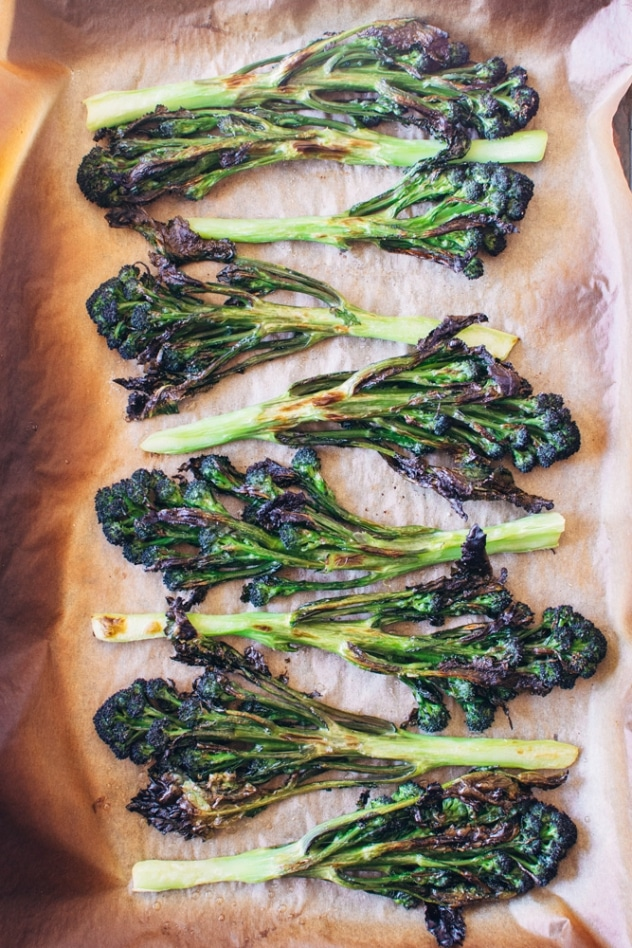 Charred purple sprouting broccoli with caper basil tahini sauce is a simple spring vegetable recipe with purple sprouting broccoli and an easy to make tahini sauce that's elevated with garlic, lemon, capers and basil, topped with some toasted sunflower seeds for crunch.