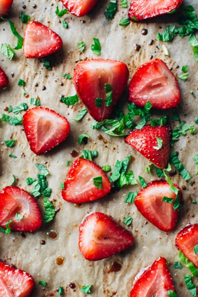 Roasted strawberries with mint and airy yogurt cream - A delightfully sweet and simple spring indulgence that's refined sugar free made with balsamic roasted strawberries, torn fresh mint, and an airy probiotic rich yogurt cream.