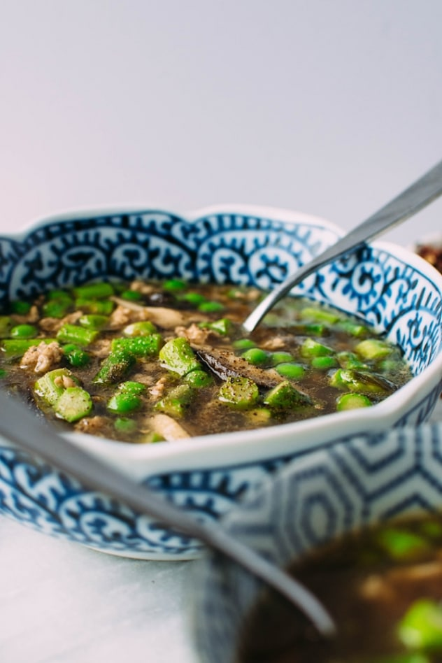 Gingered pork soup with green spring vegetables and szechuan broth made with asparagus, peas and shiitake mushrooms - it's an umami rich bowl of goodness and the perfect way to warm up AND indulge in some of the new spring vegetables that are making their way into our markets.