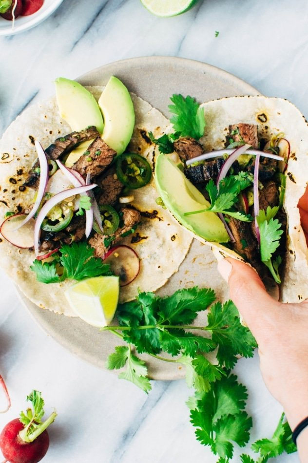 Spicy thai marinated skirt steak tacos and avocado are super bold and umami packed paleo friendly tacos that are super versatile and easy to make!