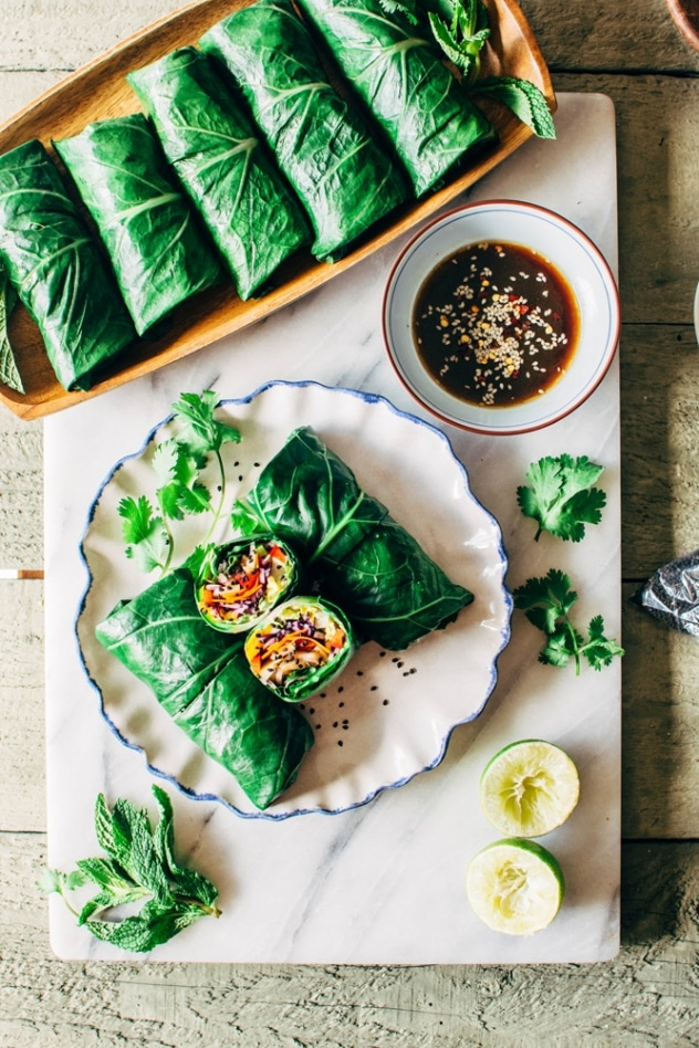 Rainbow collard green spring rolls with shrimp! Layers of tangled crunchy veggies, perfectly pan seared shrimp, spicy mayo, all tucked inside some SUPER HEALTHY collard green wraps!