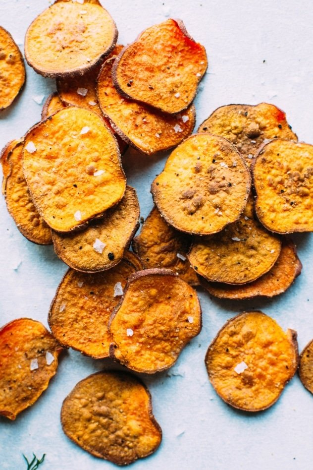 Healthy oven baked sweet potato chips with dairy free ranch dressing! A salty, crunchy and satisfying make at home snack that's loaded with anti-oxidants and healthy fats.
