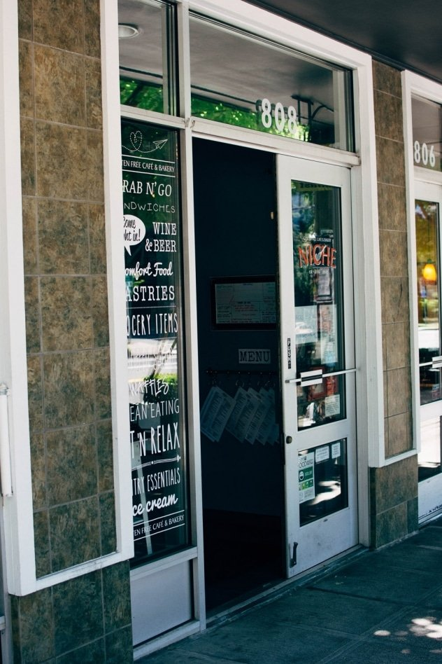 Niche - a gluten free bakery and cafe in Seattle, WA! Get ready to be tempted by some seriously mouth-watering treats as you browse their main menu since the ordering counter is lined with whatever sweet treats are fresh baked for the day - you may even be able to watch them frosting some cupcakes or pulling cookies out of the oven, as their workspace is directly behind it. Their non-bakery items menu consist mostly of various types of sandwiches, bowls, salads, and WAFFLES and waffle-inis!