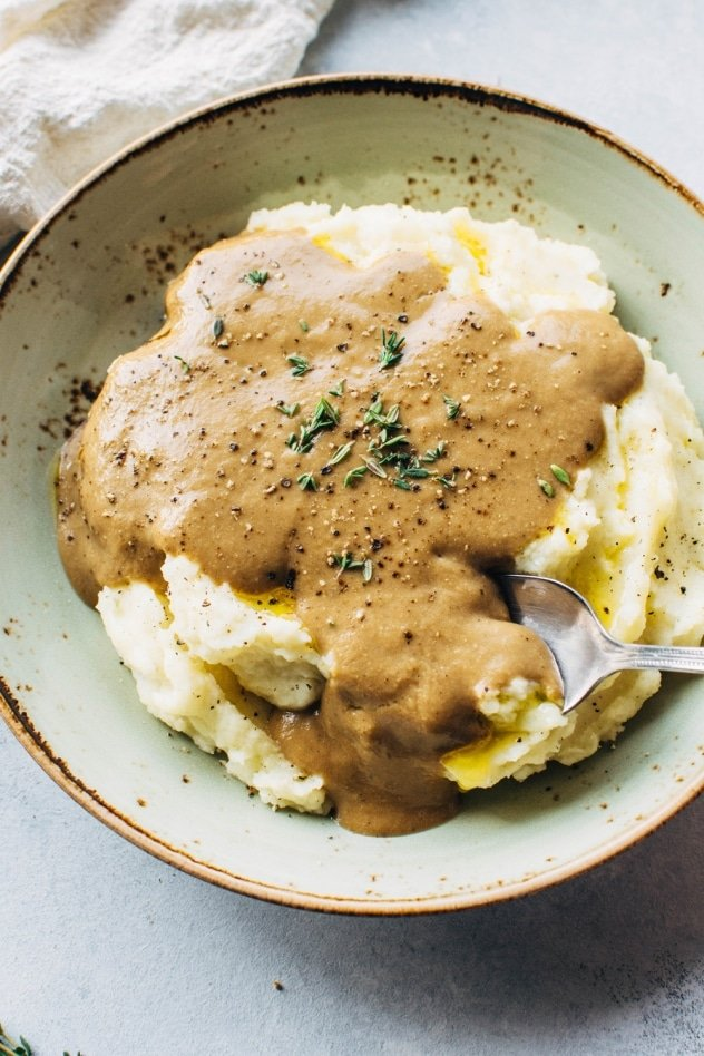 Easy make ahead paleo gravy! Rich and full of flavor, this gravy is made without any binders or thickeners - perfect for your paleo or vegan table!