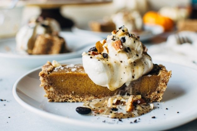 No bake pumpkin tart with salted coffee caramel that is paleo and dairy free! SO easy to make and packed full of fall flavors, this dessert is sure to please everyone at your table!