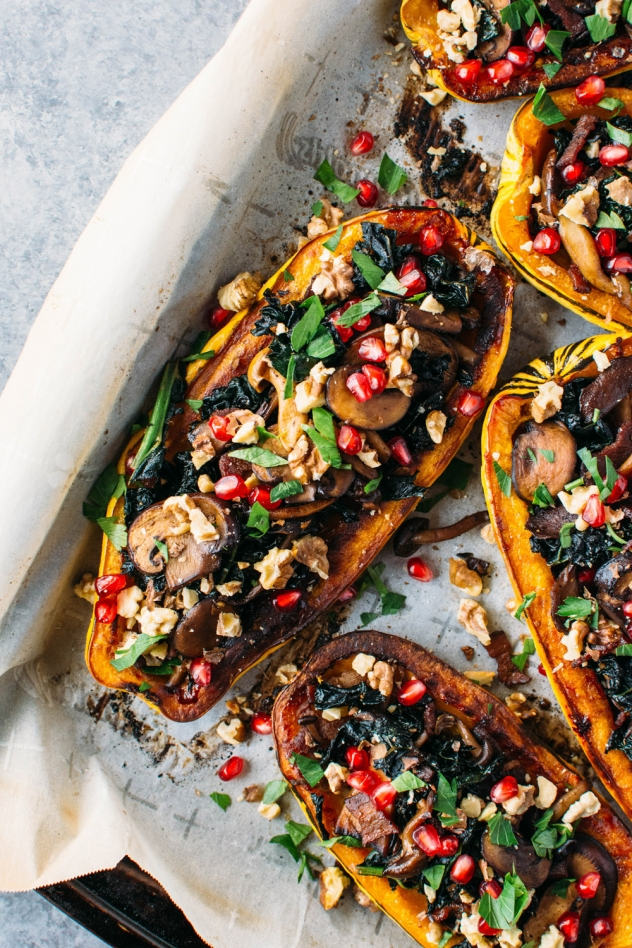 Roasted delicata squash stuffed with kale and maple cinnamon roasted mushrooms is literally bursting with brilliant seasonal flavor and color!