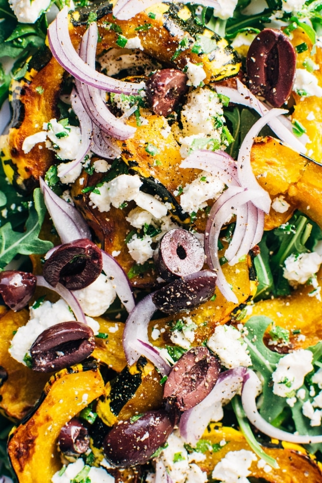 This roasted squash and arugula greek salad is made with maple chili roasted winter squash, peppery arugula and is loaded up with fresh herbs, kalamata olives, red onion and feta cheese. So much flavor and veggies make this a winning flavor bomb of a salad!