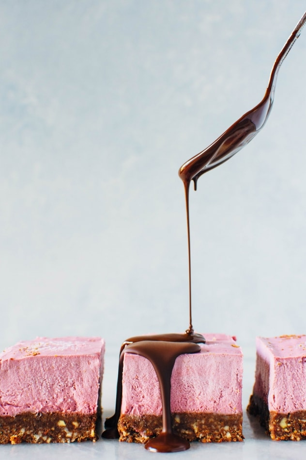 These Raspberry Chocolate No Bake Superfood Cheesecake Bars with Rawmio Chocolate are dairy free, gluten free, and refined sugar free! They're also loaded up with superfoods, healthy fats and fresh fruit! Crave worthy and good for you, they're perfect for anyone you wanna show some love on Valentine's day, or any other day of the year!