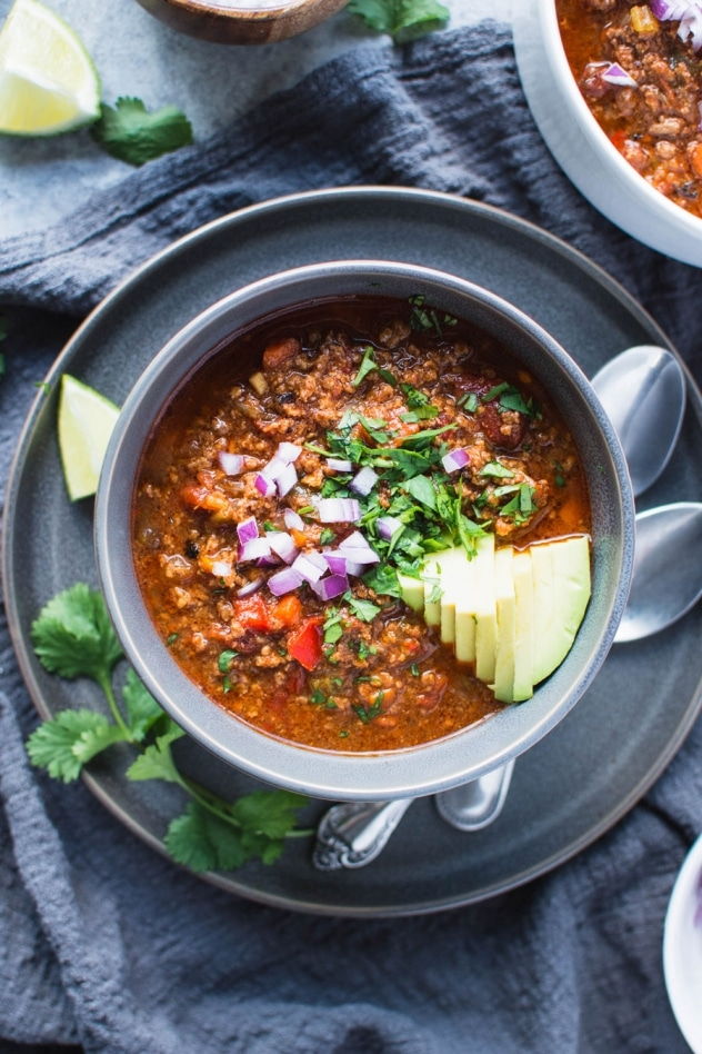 This crazy delicious chili is not only bean free (making it paleo and whole30 friendly), it's also loaded up with a rainbow of veggies - carrots, celery, onions, peppers, tomatoes, fennel and garlic that deliver serious flavor and mega nutrition!