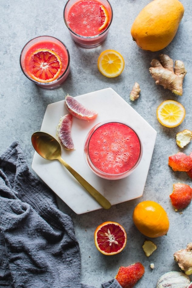 This blood orange sunshine ginger mango smoothie is made with juicy blood oranges, sweet ripe mango, bright lemon, zippy ginger and hydrating coconut water. The perfect in-between-seasons smoothie! Full of sweet and bright flavor and good for you vitamins and minerals.