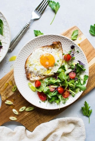 These olive oil fried eggs with a fresh herb and tomato salad are made with only a few ingredients and are legit a delightful dream of a real food breakfast! Or lunch, or dinner, if you're the kind of person who could eat fried eggs for every meal #totallyme.