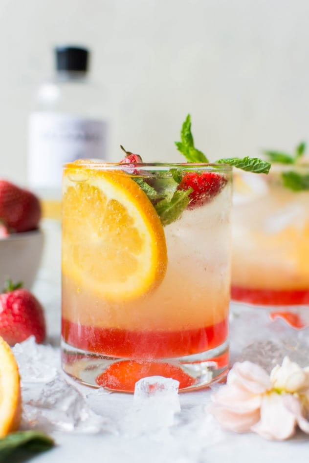 This naturally sweetened strawberry mint shrub is made with juicy seasonal strawberries, fresh mint, white balsamic vinegar, and honey! It's a brilliant bright and tart base for refreshing drinks that you'll enjoy all summer long.