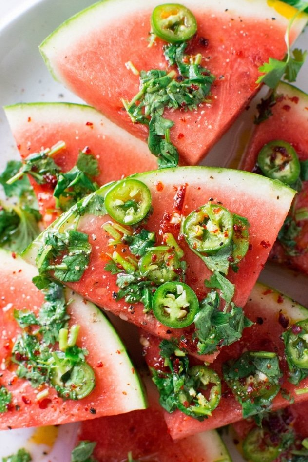 Are you guys ready for this insanely delicious spicy watermelon salad with cilantro and lime!? It's spicy, sweet, a little bit salty and doused in a super lime-y dressing for the ultimate watermelon salad experience - refreshing and FULL of summer flavor!