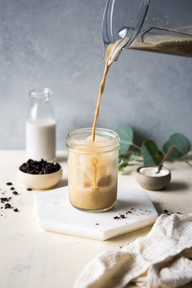 This creamy collagen boosted iced coffee is made with your favorite cold brew coffee, almond milk, maple syrup, vanilla, a pinch of sea salt, and of course, collagen! Super easy to make and a seriously delicious caffeinated pick-me-up.