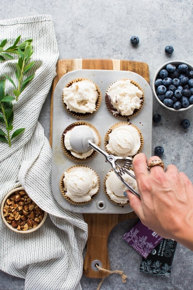 These dark chocolate blueberry almond ice cream cups are gluten free and vegan - made with your favorite non dairy ice cream, the BEST only-slightly-sweet chocolate from Rawmio, almond butter, blueberries, and salty toasted almonds for a mouth-watering combo that will knock you off your feet!