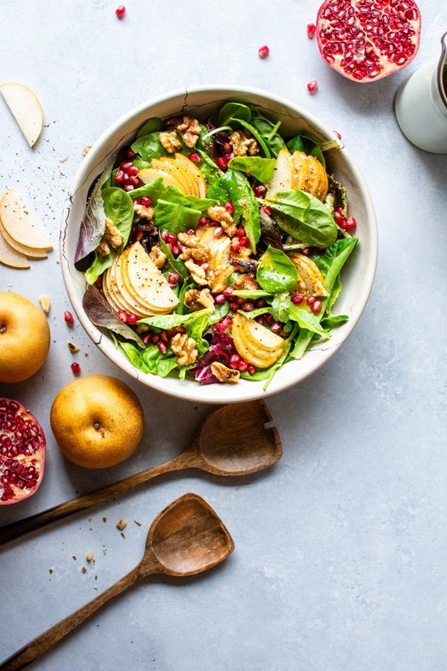 This asian pear and walnut salad with a maple mustard vinaigrette is fall salad DREAMS. Made with tender salad greens, thinly sliced asian pear, toasted walnuts, sweet pomegranate seeds, and a zippy maple mustard vinaigrette that you'll want to put on everything.