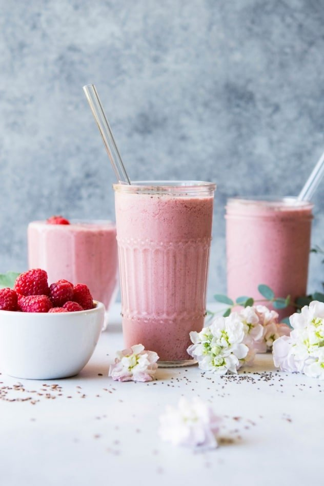 This raspberry mango healthy gut smoothie is the perfect snack or breakfast for whenever your body needs a little extra love! Made with raspberries, mango, probiotic rich coconut yogurt, almond milk, and chia and flax seeds for extra fiber and omega 3 fatty acids