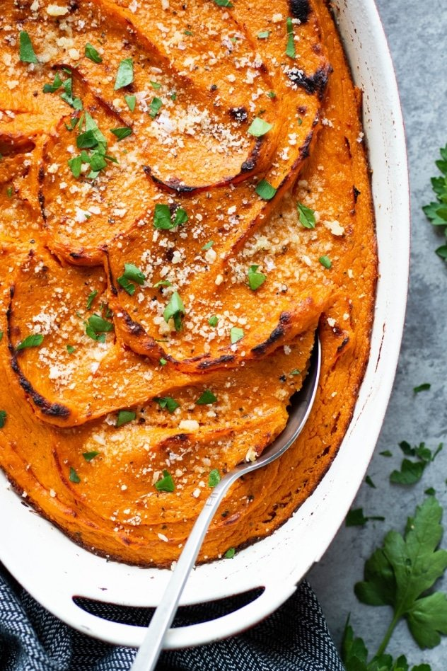 This twice baked garlic parmesan sweet potato casserole is a savory twist on a classic autumn side dish. Made with smooth and luscious sweet potatoes, parmesan cheese, and roasted garlic. Nourishing, delicious, and full of flavor!