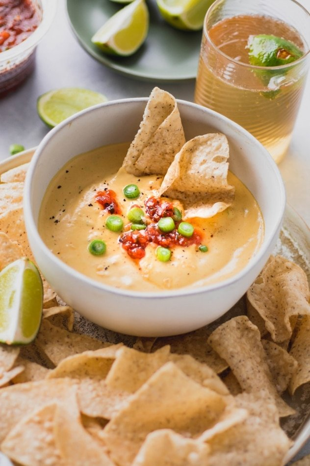 This creamy cashew queso dip is made with ZERO processed ingredients, for an authentic tasting, full flavored, dairy free alternative to this well loved dip. SO crave worthy and made with anti-inflammatory, good-for-you ingredients! Vegan + whole30 compliant.