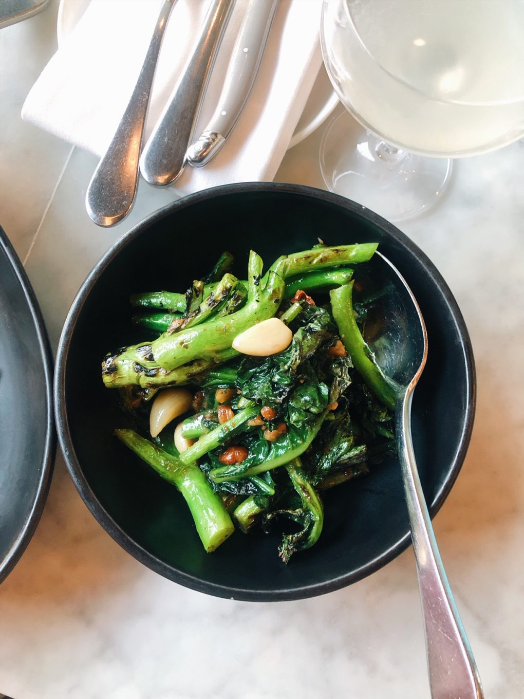 Overhead view of chinese broccoli with walnut pesto at Joule Restaurant in Seattle