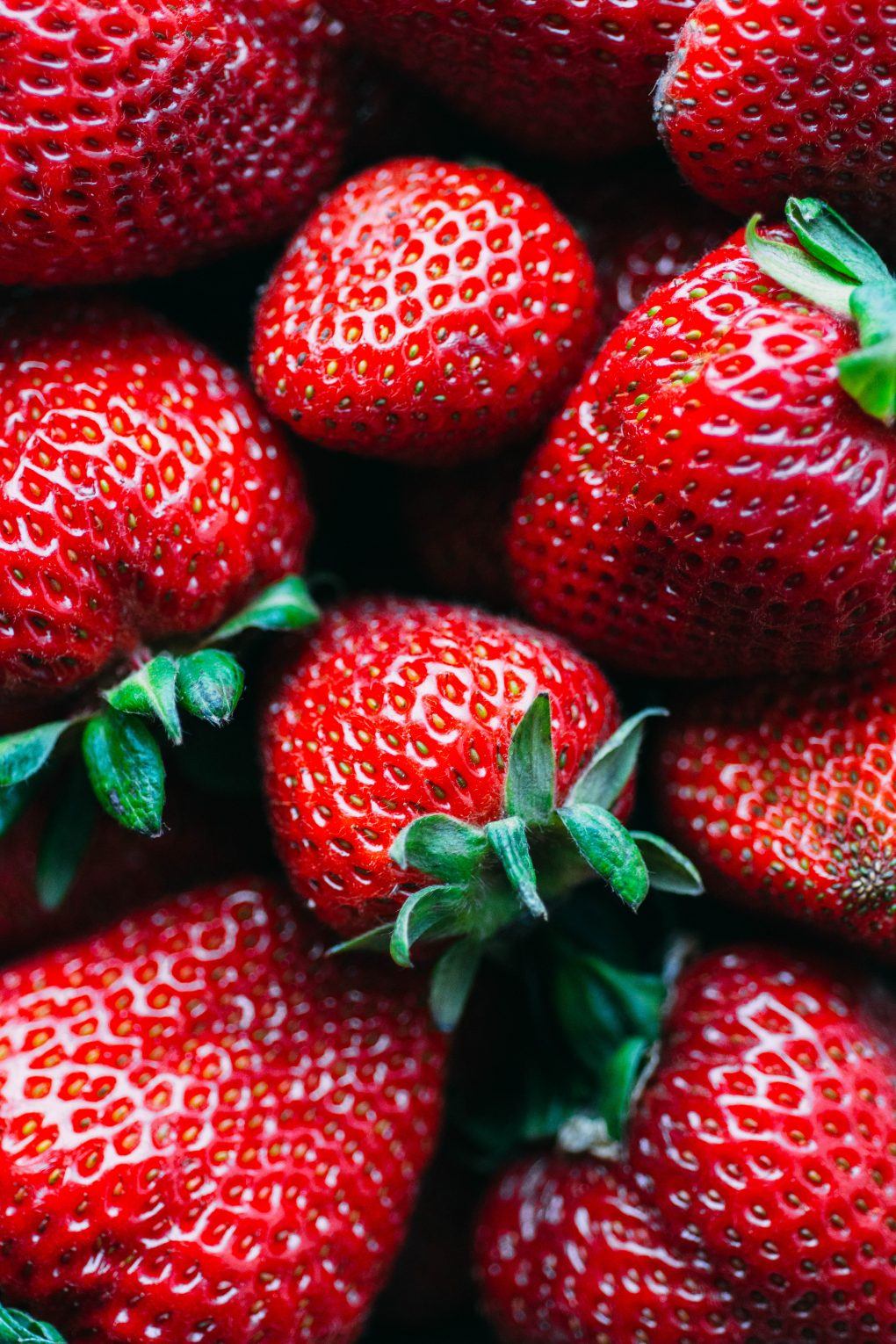 A close up view of some bright red fresh strawberries