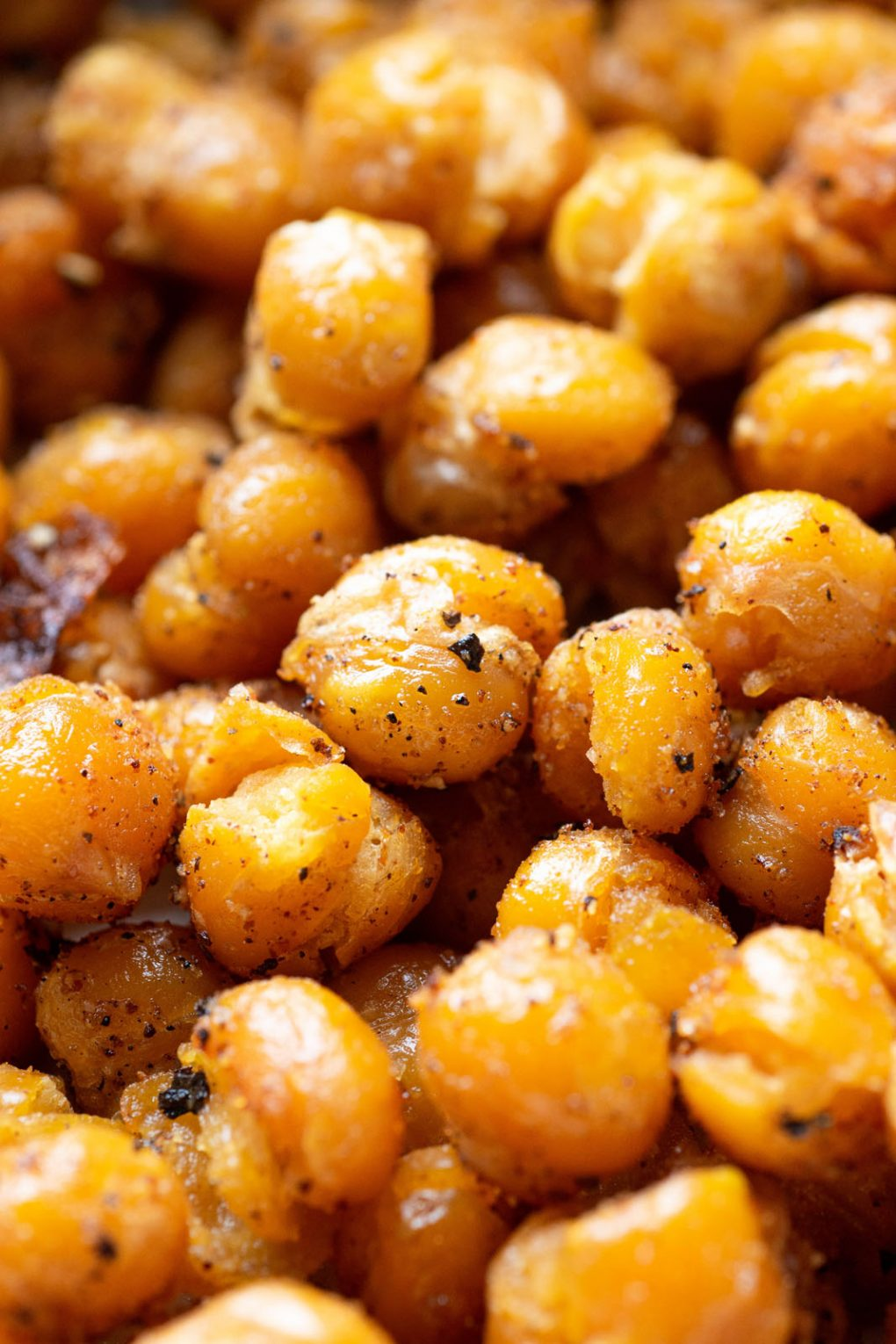 Super close up shot of browned and crispy roasted chickpeas.