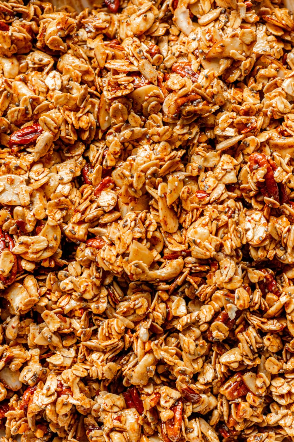 Overhead image of un-baked gluten free granola pressed into a baking sheet.