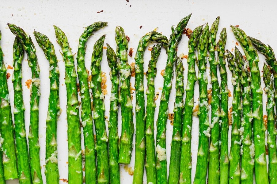 Overhead landscape style image of crispy oven roasted asparagus with lots of garlic.